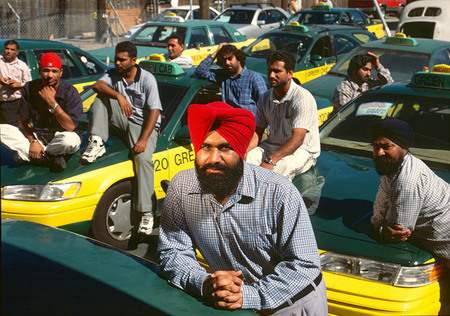 Aman Singh, owner of Green Cab, with employees suffering the economic consequences of 911, for Businessweek
